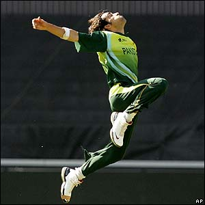 Umar Gul does a Billy Elliot after taking a skied return catch to remove India's danger man Yuvraj Singh