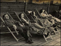 Karl Hoecker and SS women relax on lounge chairs in Solahuette (courtesy United States Holocaust Memorial Museum)