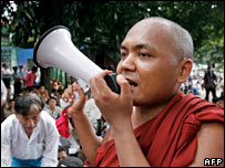 A monk shouts through a loudspeaker in Rangoon on 24 September 2007