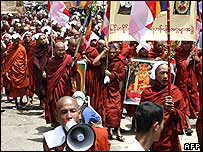 Buddhist monks march down a street in protest in Rangoon, 25 September 2007