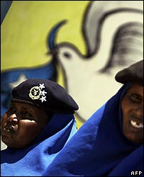 Somali police women standing in front of a poster calling for peace