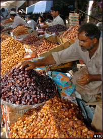 A row of shops selling dates in Pakistan