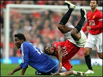 Mikel (left) tackles Evra (right)
