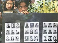 Protesters display pictures of alleged victims of military crackdown in Myanmar during a rally commemorating the 19th anniversary of the military crackdown Wednesday,  Aug. 8, 2007