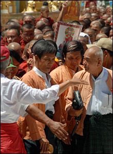 Protestors with monks