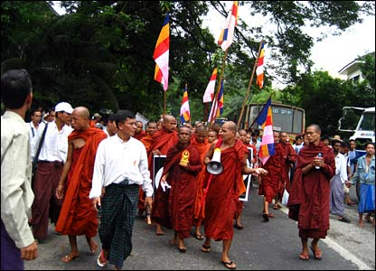 Monks marching with flags