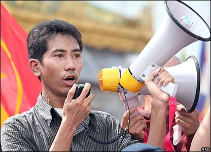 A man speaks to the crowd as they gather in central Rangoon, 25 September 2007,