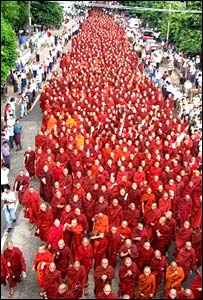 Monks march along a street of Rangoon, Burma (Photo: Ko Htike)