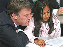 Ed Balls with a school pupil