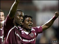 Hearts striker Christian Nade (left) celebrates with team-mate Laryea Kingston
