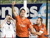 Lee Wilkie celebrates putting Dundee United in front