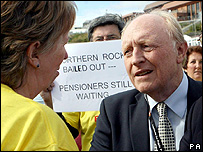 Lord Kinnock confronts protesters