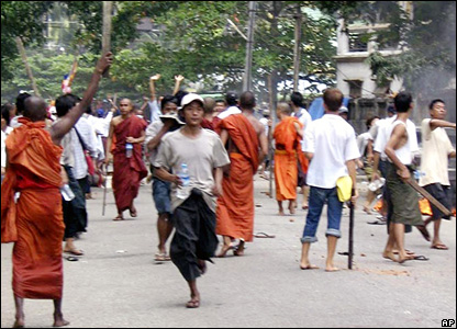 Photograph from Burmese opposition group, National League for Democracy-Liberated Area, shows a Buddhist monk and demonstrators holding sticks in Rangoon, 26 September 2007