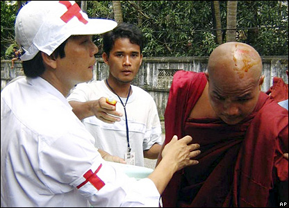 Photograph from Burmese opposition group, National League for Democracy-Liberated Area, shows Myanmar Red Cross workers treating an injured monk, Rangoon, 26 September, 2007