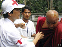 Wounded monk is treated by medics amid Burma protests