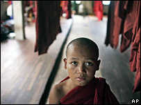 A Young Buddhist monk looks on following devotional Wednesday, Oct. 11, 2006, at the Sayadaw Bhaddanta Kaveinda orphanage on the outskirts of Rangoon