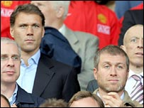 Marco van Basten (left) sits behind Roman Abramovich at Old Trafford on Sunday