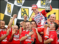 Casey Stoner and the Ducati team celebrate his MotoGP championship win