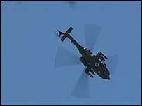 An Apache helicopter in the air