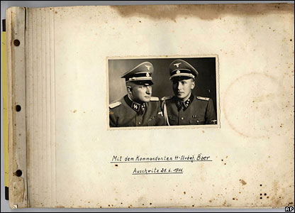 Front page of the photo album, showing Auschwitz commander Richard Baer (left) and Karl Hoecker