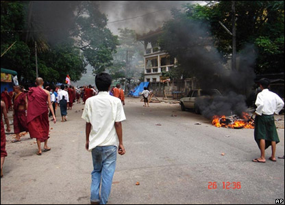 Photo released by the Democratic Voice of Burma show fires in the streets of Rangoon as monks protest