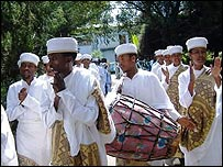 Priests playing drum