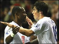 Gareth Bale and Didier Zokora celebrate the Welshman's goal