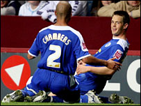 Matty Fryatt celebrates scoring Leicester's winner with James Chambers