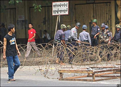 A man walks past a police blockade in central Rangoon (photo supplied by the Mandalay Gazette)