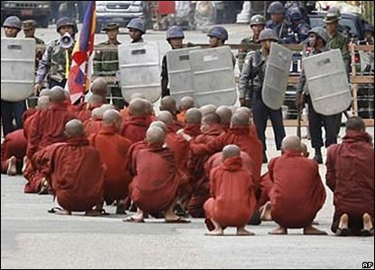 Buddhist monks pray at a riot police road block in central Rangoon (photo supplied by the Mandalay Gazette)