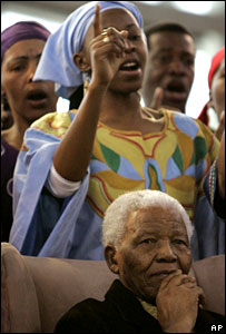 Nelson Mandela listens to singers at the opening of Maponya Mall in Soweto
