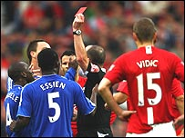 Chelsea players including John Terry surround Mike Dean as he sends off Mikel Jon Obi