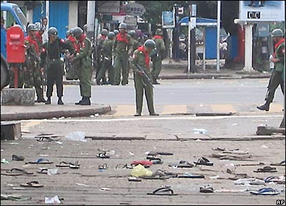 Protesters' sandals are scattered on the ground in front of soldiers in central Rangoon (photo supplied by the Mandalay Gazette)