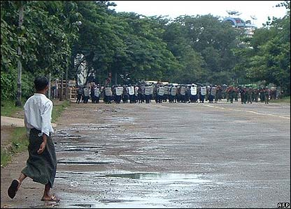 Armed troops line up across a street in Rangoon (AFP/Mandalay Gazette)