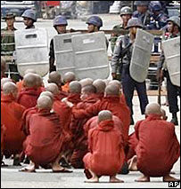 Buddhist monks pray at a road block in downtown Rangoon. Pic courtesy Mandalay Gazette