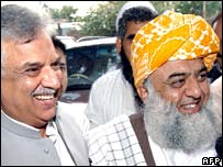 APDM leaders Zafar Iqbal Jaghra (left) and Maulana Fazlur Rehman in Peshawar, 27 September