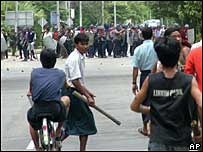 Protesters face security forces in Rangoon on Thursday 27 September 2007