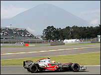 Lewis Hamilton goes about his business in the shadow of Mount Fuji at the Japanese Grand Prix