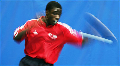 Darius Knight helping table tennis