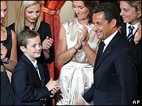 French President Nicolas Sarkozy and his son Louis