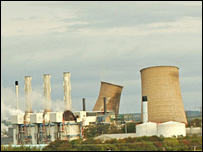 Two cooling towers exploding (Press Association)