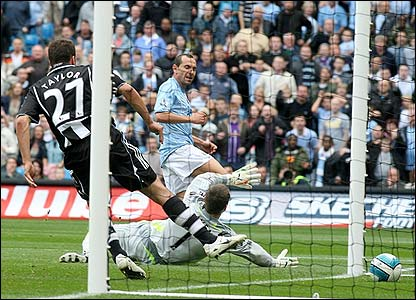 Martin Petrov slots home Man City's opening goal