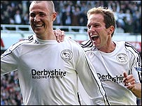 Kenny Miller (left) celebrates his goal with Eddie Lewis