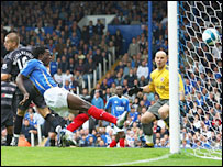 Benjani bundles home the first of 11 Fratton Park goals