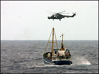 A vessel is intercepted by a Royal Navy helicopter