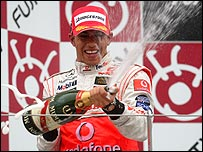 Lewis Hamilton celebrates his victory in the Japanese Grand Prix