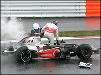 Fernando Alonso climbs out of his car after his crash during the Japanese Grand Prix