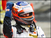 Heikki Kovalainen celebrates second place in the Japanese Grand Prix