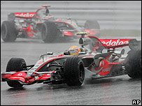Lewis Hamilton leads McLaren team-mate Fernando Alonso in the early stages of the Japanese Grand Prix
