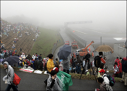 Wet and foggy conditions make driving difficult at the Japanese Grand Prix at Fuji